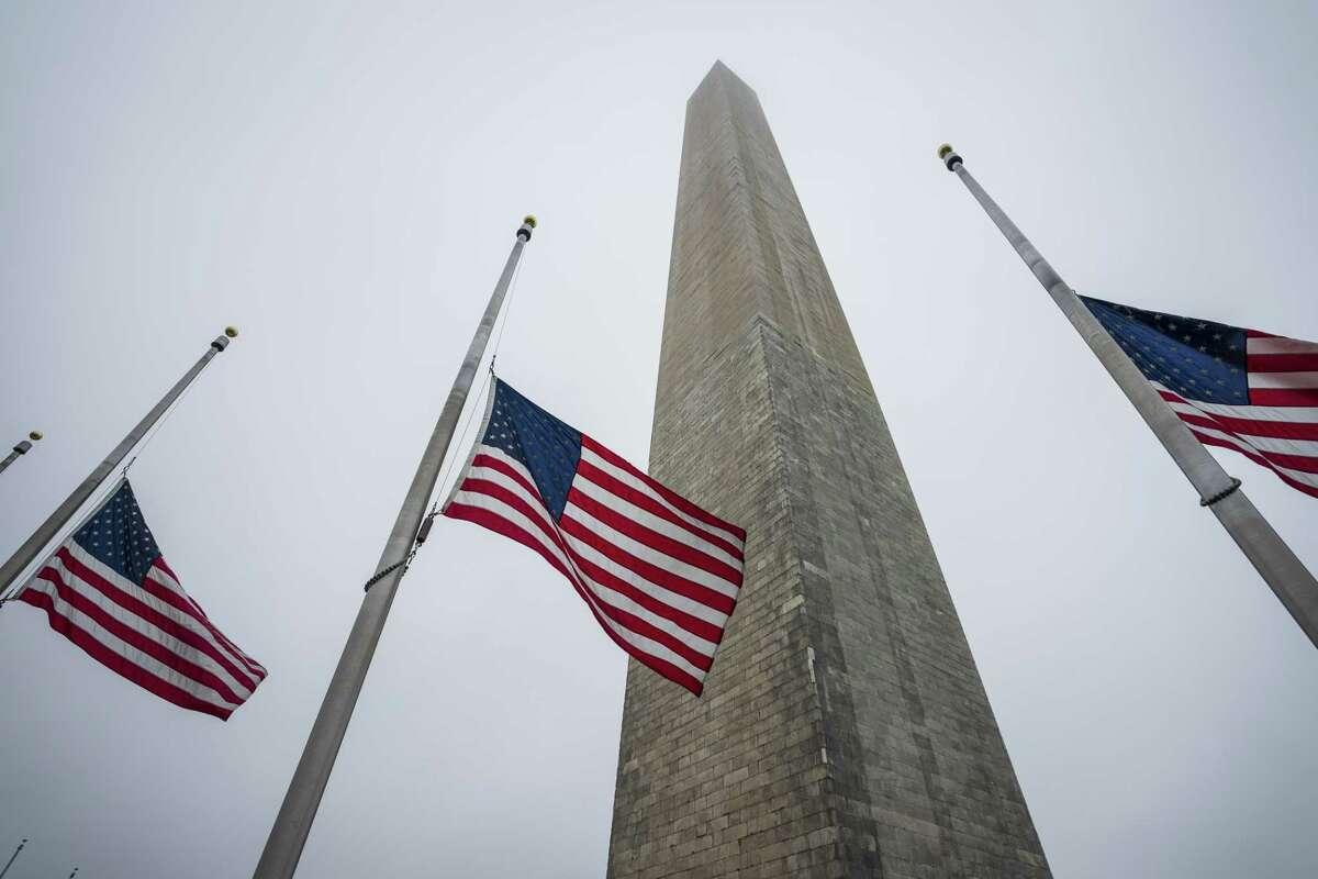 WASHINGTON, DC - MAY 22: American flags fly at half-staff near the Washington Monument on the National Mall, May 22, 2020 in Washington, DC. (Photo by Drew Angerer/Getty Images)