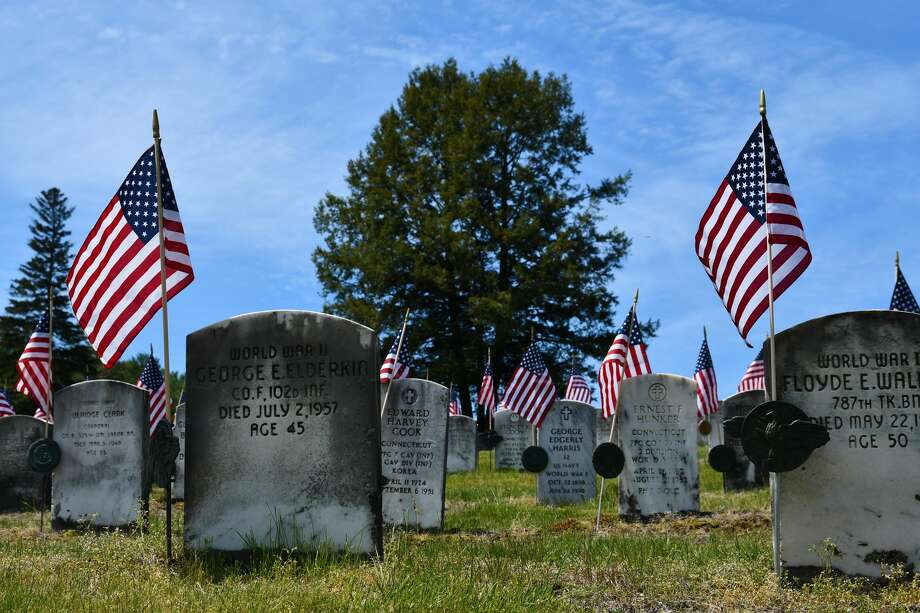 In Pictures: Memorial Day Weekend 2020 in Winsted, CT, included American Flags adorning cemetarys as well as a lot of very happy people enjoying outdoor activities, including live music at Little Red Barn Brewery, outdoor social distance dining and fun on Highland Lake. Photo: Lara Green- Kazlauskas/ Hearst Media