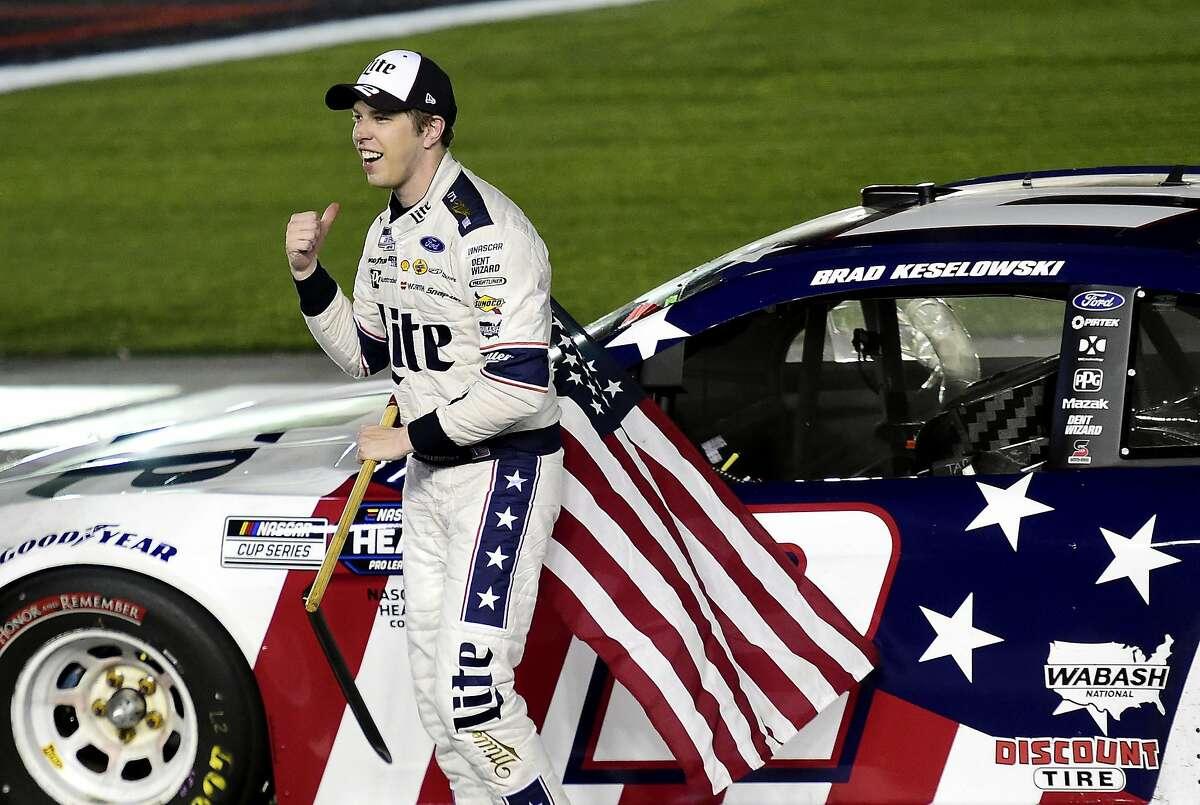 Brad Keselowski celebrates after winning the NASCAR Cup Series Coca-Cola 600 at Charlotte Motor Speedway.