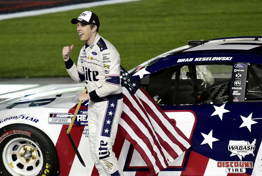 Brad Keselowski celebrates after winning the NASCAR Cup Series Coca-Cola 600 at Charlotte Motor Speedway. Photo: Jared C. Tilton / Getty Images