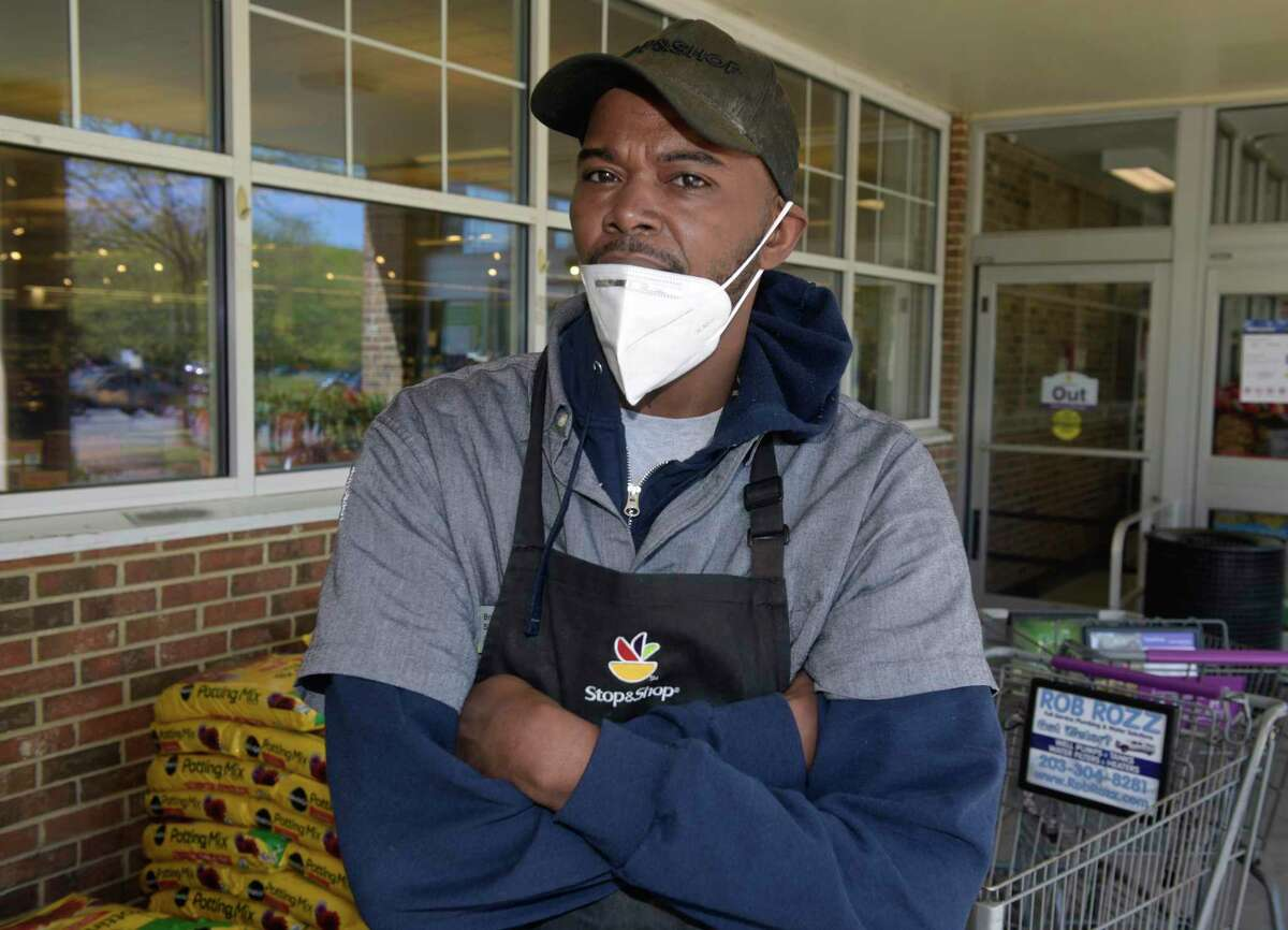 Brian Simmons, who works at the Newtown Stop&Shop, is one of the many grocery workers in the state who have continued to go to work amid a pandemic, despite risks to their health. Adding to that stress is the understanding that, despite the efforts of advocates, they are not guaranteed workers' compensation by the state if they were to fall ill.Thursday, May 21, 2020, in Newtown, Conn. Simmons is also a union steward and executive board member at the Food and Commercial Workers Union Local 371.