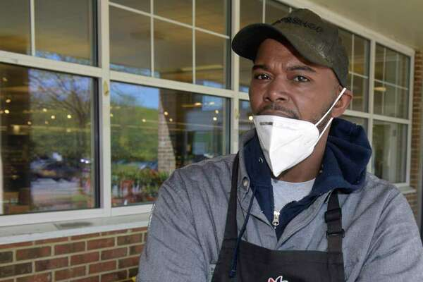 Brian Simmons, who works at the Newtown Stop&Shop, is one of the many grocery workers in the state who have continued to go to work amid a pandemic, despite risks to their health.