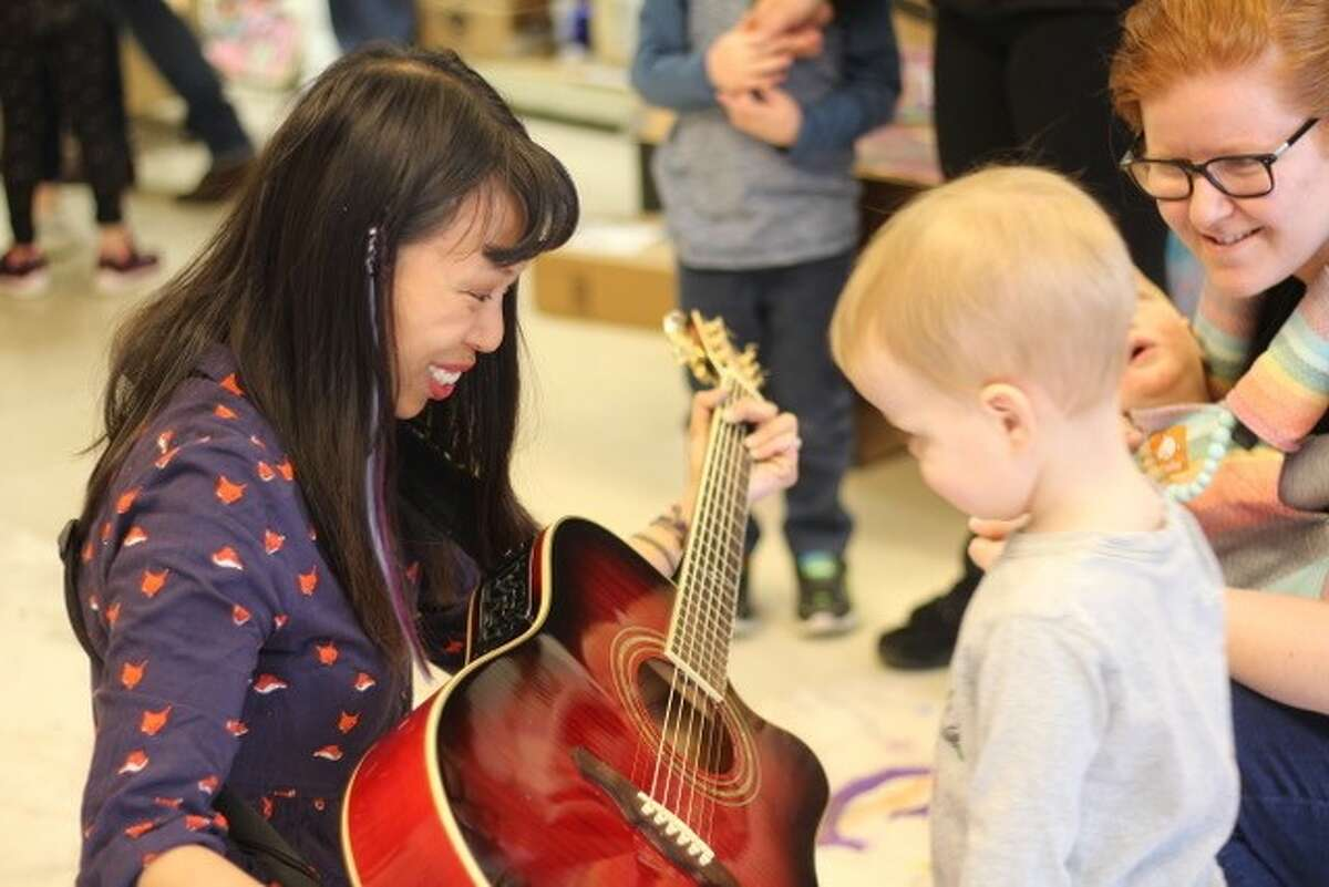Kim Tateo plays guitar during a previous summer camp at the Arts Center for the Capital Region.