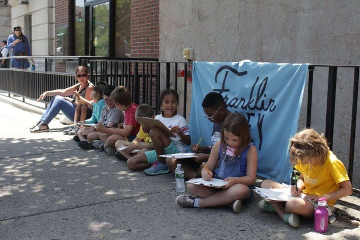 Students make art al fresco in Troy during a previous summer camp at the Arts Center for the Capital Region.