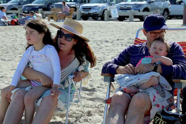 The Brunwasser family of Westport enjoy the day at Compo Beach on Sunday, May 24, 2020, in Westport, Conn.