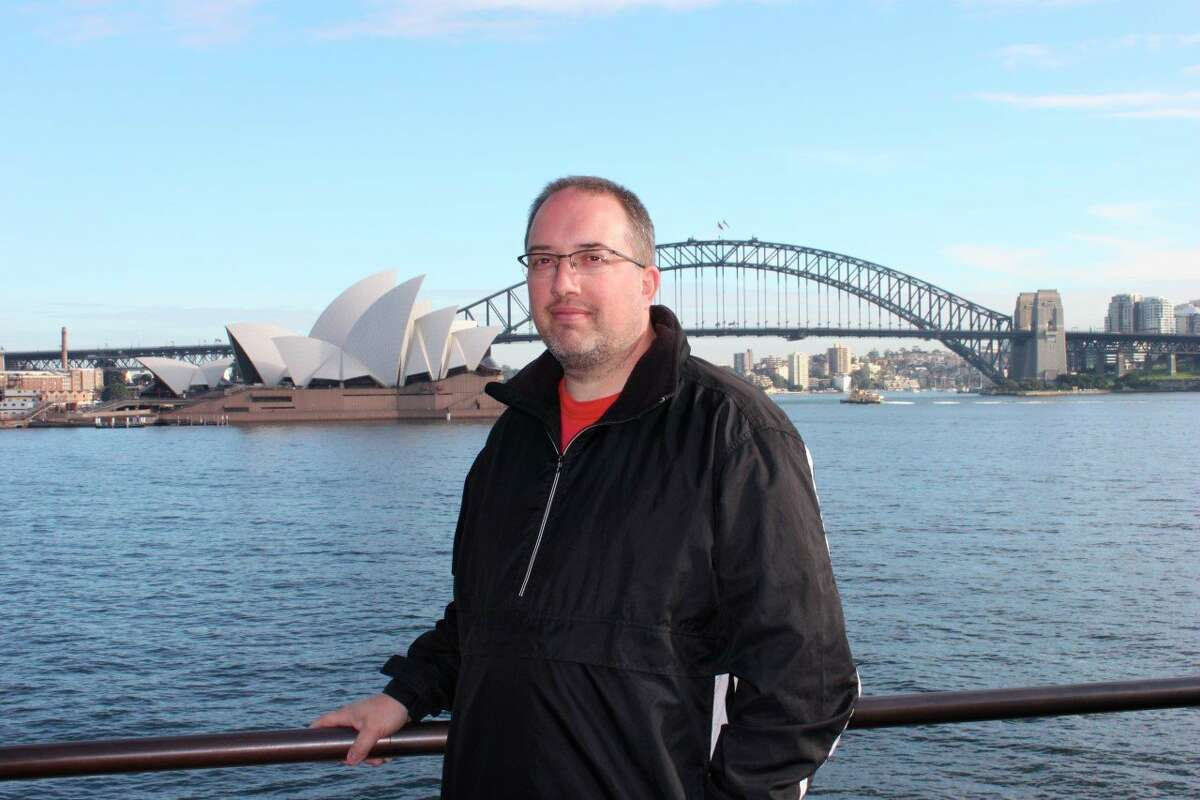 Dale Rogers stands in front of the Sydney Opera House during one of his excursions abroad. He has enjoyed taking students on many trips over the years. (Courtesy photo)