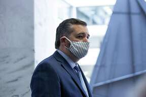 Senator Ted Cruz, a Republican from Texas, wears a protective mask while arriving for the weekly Senate Republican caucus luncheon at the Hart Senate Office Building in Washington, D.C., U.S., on Tuesday, May 19, 2020. Trumpthreatened to withdraw altogether from the World Health Organization, a move that would leave Chinese leaderXi Jinpingas the most prominent voice leading the global fight against the pandemic. Photographer: Stefani Reynolds/Bloomberg