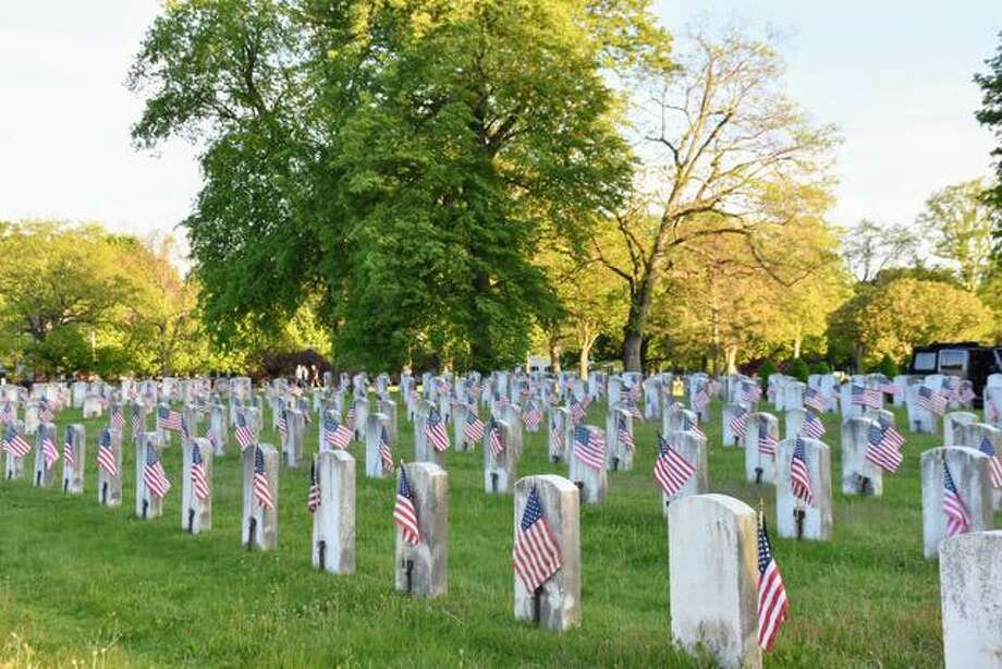 Darien Scouts (safely, using social distancing practices) were able to place the flags at Darien's Spring Grove Cemetery Assoc in anticipation of Memorial Day. Photo: Sabina Harris