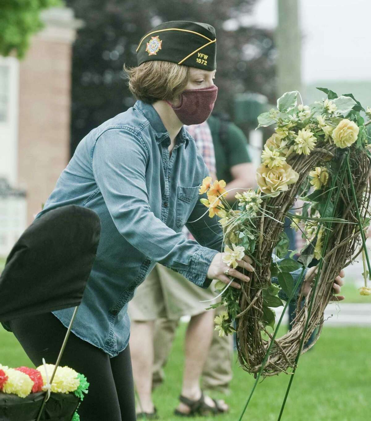 Carrie Hanna, of New Milford, Navy retired, places a wreath at the memorial on the green at New Milford's Memorial Day Service. Monday, May 25, 2020