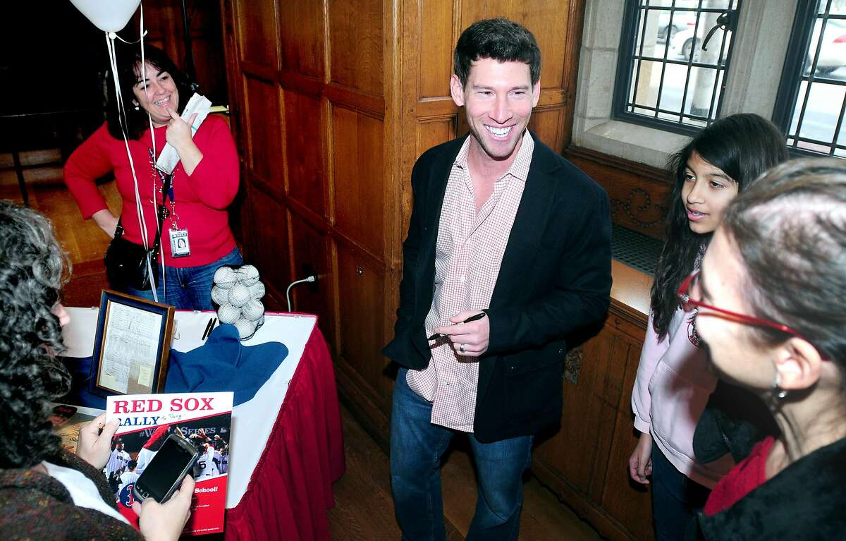 Red Sox relief pitcher Craig Breslow (center) meets with fans at the Yale Law School in New Haven on 1/27/2014. Photo by Arnold Gold/New Haven Register