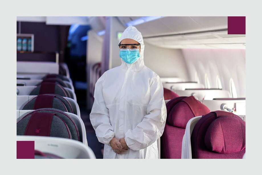 Qatar Airways announced May 18 it would require its cabin crew to wear disposable Personal Protective Equipment as well as safety goggles, gloves and a mask. Photo: Amer Sweidan/Courtesy Of Qatar Airlines / Amer Sweidan/Courtesy of Qatar Airlines