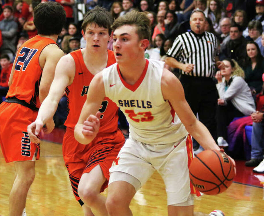 Roxana's Gavin Huffman (23) drives past Pana's Wes Kile during a SCC game Feb. 11 in Roxana. Huffman, who enters his senior season ranked No. 3 on the Shells' all-time scoring chart at 1,384 points, will open his final season with the Shells in Roxana's first Thanksgiving Tournament. Photo: Greg Shashack / The Telegraph