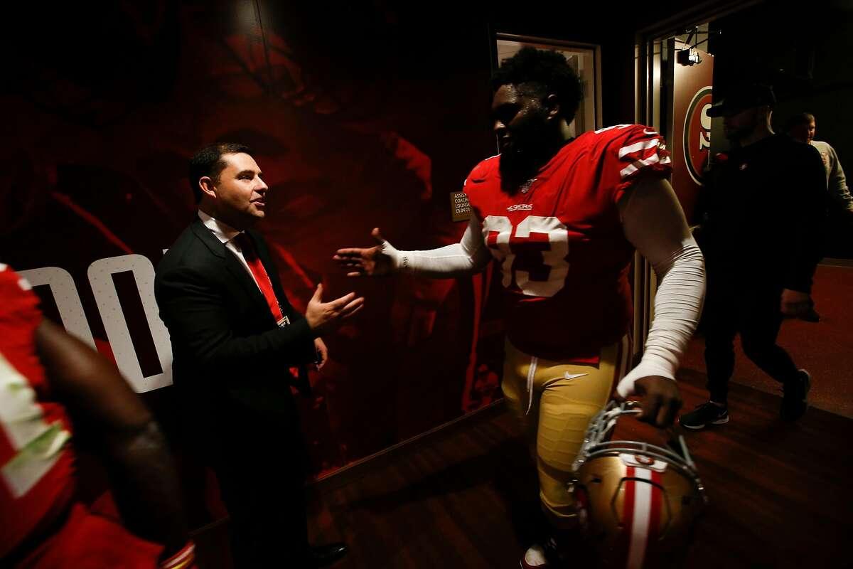 SANTA CLARA, CA - NOVEMBER 24: CEO Jed York of the San Francisco 49ers congratulates D.J. Jones #93 at the locker room following the game against the Green Bay Packers at Levi's Stadium on November 24, 2019 in Santa Clara, California. The 49ers defeated t