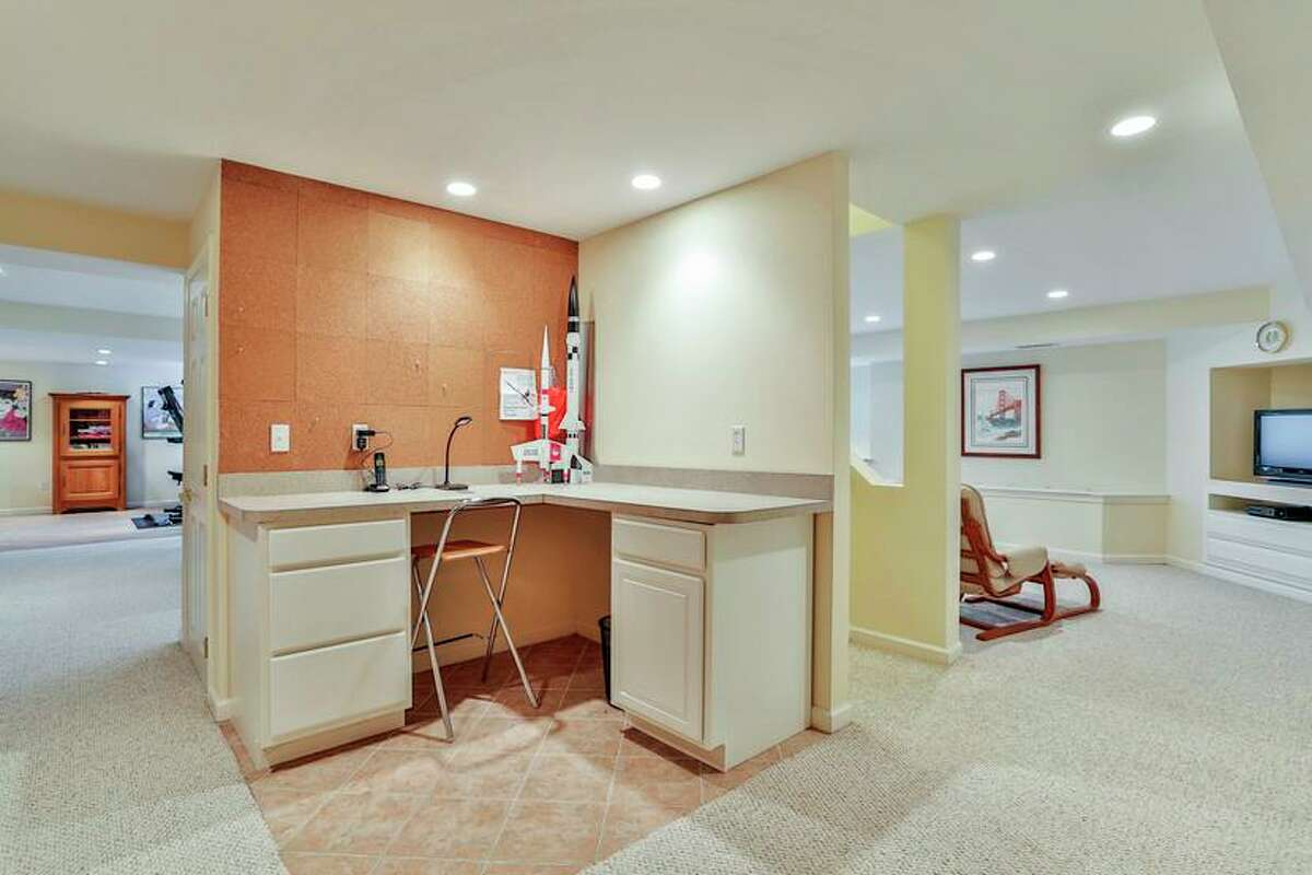 A built-in desk area on the lower level can serve as a homework station, or a craft or sewing space.