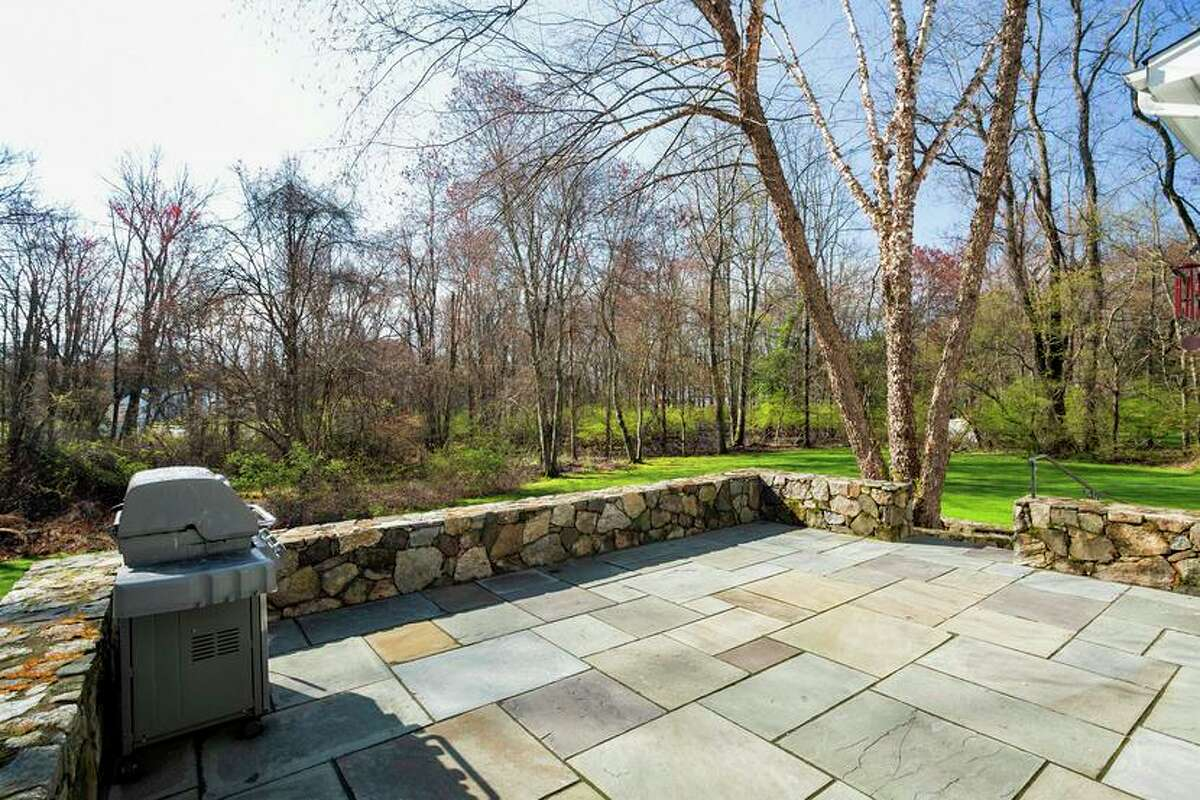 On this 2.74-acre level property there is a large bluestone patio with a stone sitting wall.