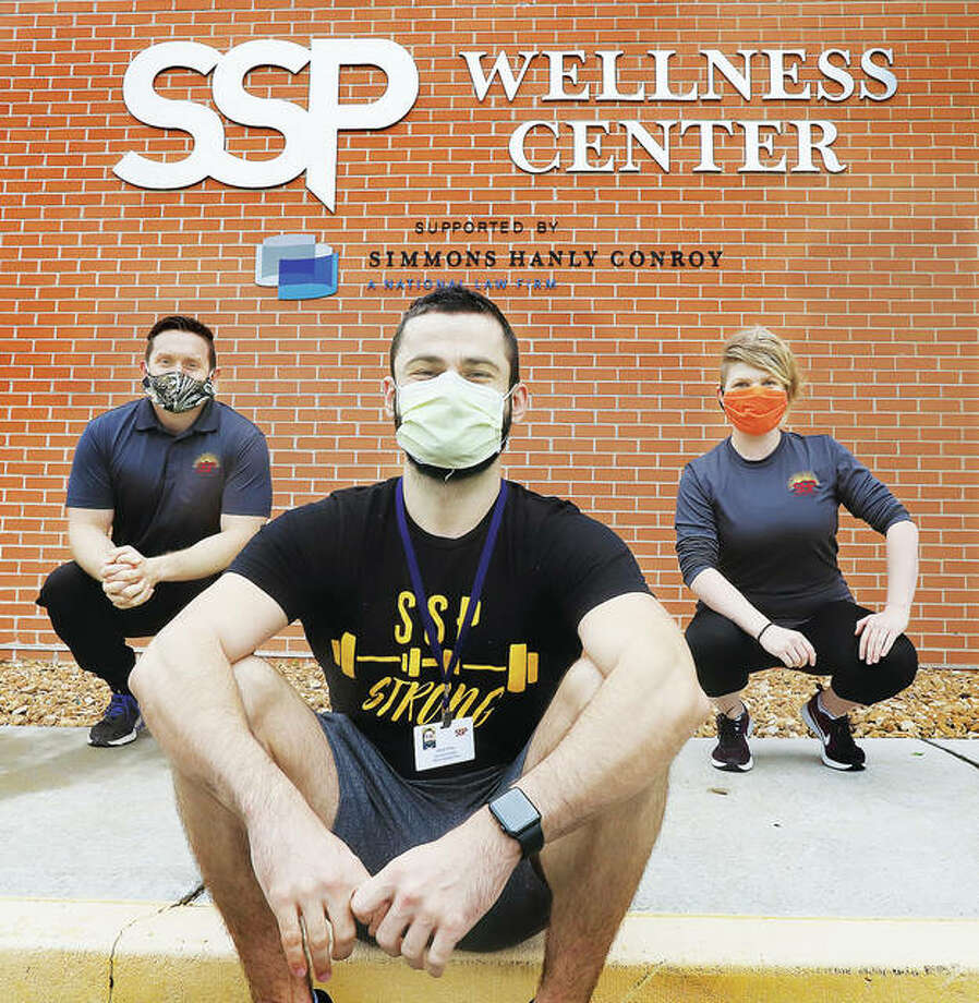 The wellness coordinators at the SSP Wellness Center in Alton can't go inside the closed facility right now. But they are staying busy providing online training sessions for people from home and helping to deliver the Meals on Wheels. From left are Dustin Heiser, Jacob Shaw and Kelsi Harre. The crew says they will be ready to resume in-person training as soon as the center is allowed to re-open.
