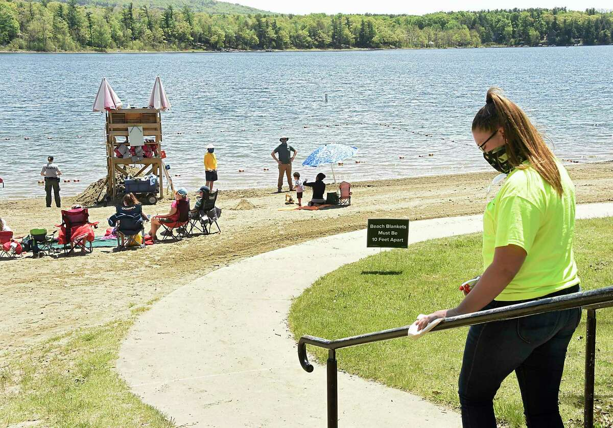 People practice social distancing at the beach at Thompson's Lake Campground on Monday, May 25, 2020 in East Berne, N.Y. The state lifted the closure of state campsites on Monday but few people seemed to be camping. (Lori Van Buren/Times Union)(Lori Van Buren/Times Union)