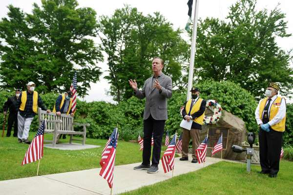 Connecticut Gov. Ned Lamont speaks during the Memorial Day ceremony at the Cos Cob war memorial in Greenwich, Conn. Monday, May 25, 2020. Greenwich held Memorial Day ceremonies at the Indian Harbor Yacht Club, WWI and WWII monuments, Vietnam War monument, Eugene Merlot Park, and the Cos Cob war memorial to commemorate and remember the lives lost in battle.