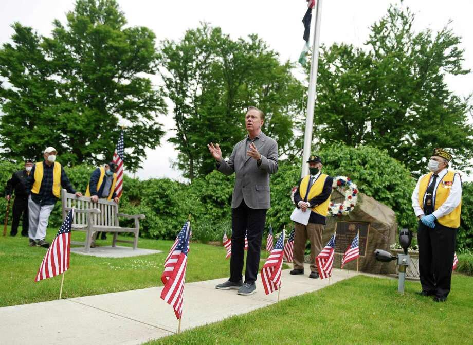 Connecticut Gov. Ned Lamont speaks during the Memorial Day ceremony at the Cos Cob war memorial in Greenwich, Conn. Monday, May 25, 2020. Greenwich held Memorial Day ceremonies at the Indian Harbor Yacht Club, WWI and WWII monuments, Vietnam War monument, Eugene Merlot Park, and the Cos Cob war memorial to commemorate and remember the lives lost in battle. Photo: Tyler Sizemore / Hearst Connecticut Media / Greenwich Time