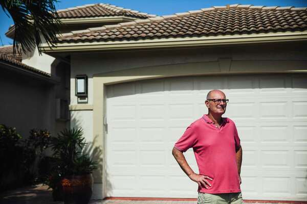 Longtime Republican Allen Lehner, 74, poses outside his home in Delray Beach, Fla., on Tuesday, May 19, 2020.