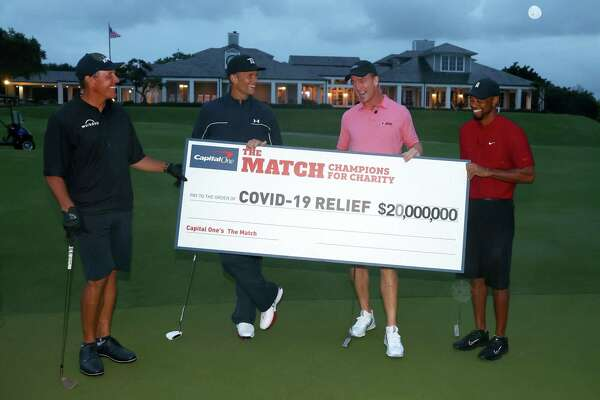 The conditions weren't quite ideal, but Sunday's charity golf exhibition featuring (from left) Phil Mickelson, Tom Brady, Peyton Manning and Tiger Woods provided entertainment during a sports-starved time while raising money for a worthy - and timely - cause.