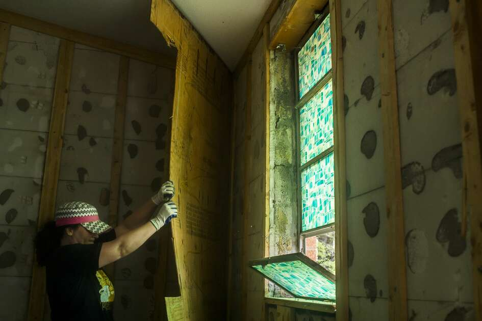 Volunteer Noelle Gaffka of Mount Pleasant works to remove a panel of wood from the wall inside Sanford Community of Christ Church Monday, May 25, 2020 in Sanford. (Katy Kildee/kkildee@mdn.net)