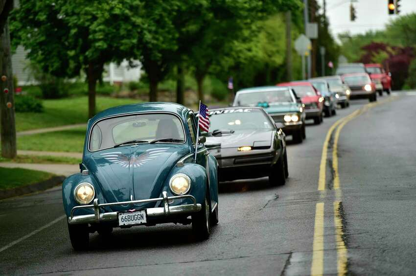 Branford, Connecticut - Monday, May 25, 2020: Organized by Eagle Scout Joseph Loffredo of Branford, 17, a Boy Scout with Troop 633, a Memorial Day drive-by procession of vehicles honoring veterans starts at Branford High School Monday morning, and parades through various parts of Branford.