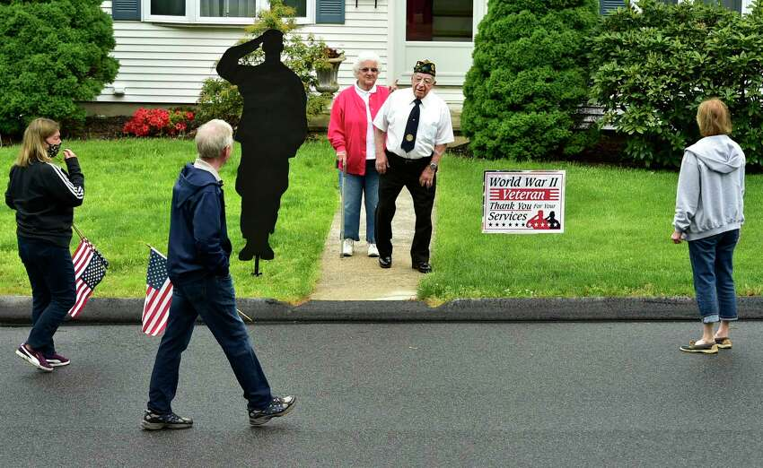 Seymour, Connecticut - Monday, May 25, 2020: Neighbors offer thanks before a Memorial Day drive-by procession of vehicles parade by the Emma Street home in Seymour Monday of World War II U.S. Navy veteran John Maiorino, 92, honoring his service, standing in front of his home with his wife of 67-years, Clare (CQ).