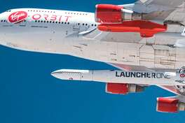 """This handout photo obtained May 25, 2020 courtesy of Virgin Orbit shows Cosmic Girl as it releases LauncherOne mid-air for the first time during a July 2019 drop test. - Small satellite launcher Virgin Orbit the sibling company to Richard Bransons space tourism venture Virgin Galactic plans to conduct the first test launch of its rocket May 25, 2020. The company has been developing and testing its vehicles for the last six years, but now its ready to finally send a rocket to orbit. (Photo by Handout / Virgin Orbit / AFP) / RESTRICTED TO EDITORIAL USE - MANDATORY CREDIT """"AFP PHOTO /VIRGIN ORBIT/HANDOUT"""" - NO MARKETING - NO ADVERTISING CAMPAIGNS - DISTRIBUTED AS A SERVICE TO CLIENTS (Photo by HANDOUT/Virgin Orbit/AFP via Getty Images)"""