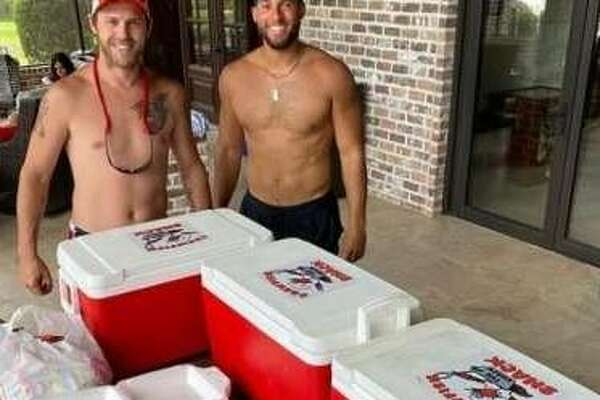 Josh Reddick and George Springer are celebrating Memorial Day with mudbugs from Crawfish Shack.