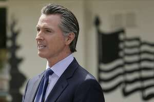 FILE - In this Friday, May 22, 2020, file photo, California Gov. Gavin Newsom speaks during a news conference at the Veterans Home of California in Yountville, Calif. California says churches can resume in-person services but the congregations will be limited to less than 100 and worshippers should wear masks, avoid sharing prayer books and skip the collection plate. The state Department of Public Health released a framework Monday, May 25 for county health officials to permit houses of worship to reopen. Most have been limited to online and remote services since March, when Gov. Gavin Newsom's stay-at-home order took effect to slow the spread of the coronavirus.. (AP Photo/Eric Risberg, Pool, File)