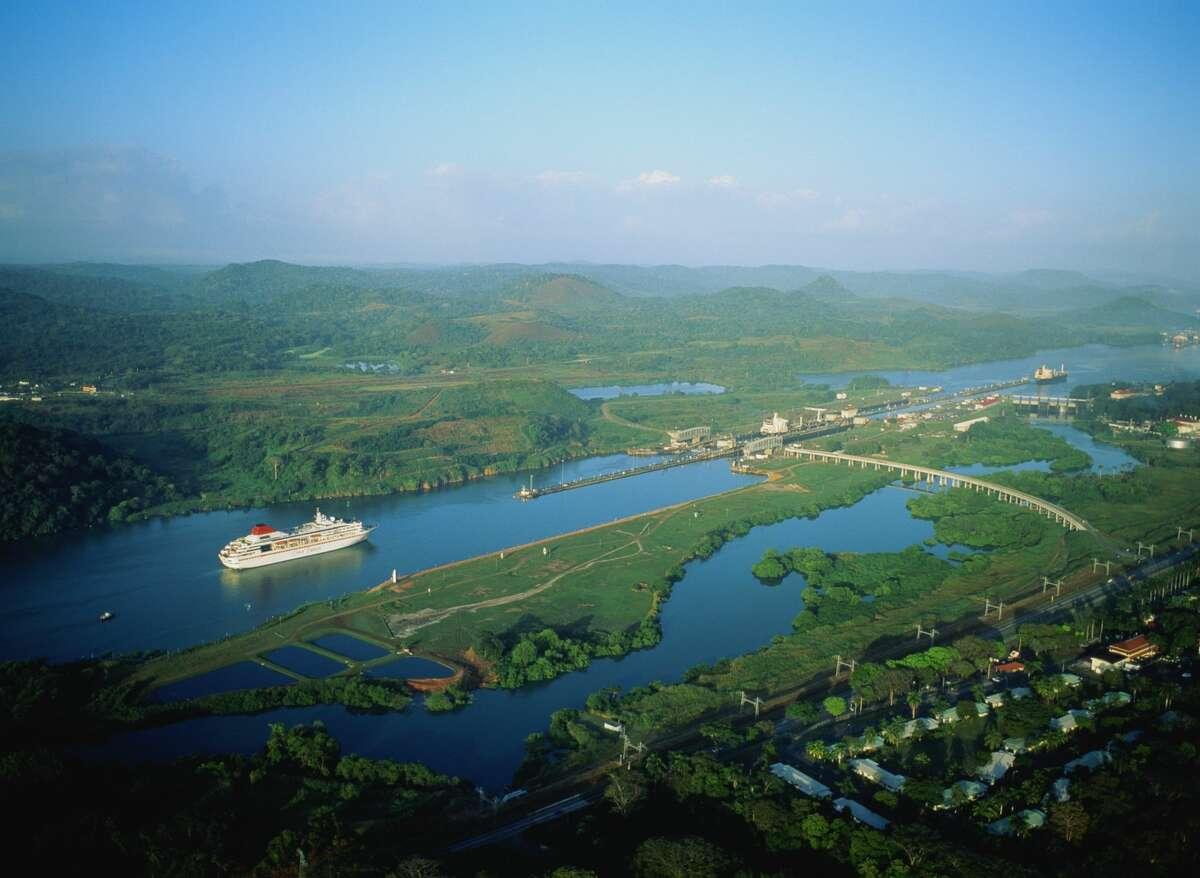 Panama Canal, liner sailing towards Miraflores locks, high view.