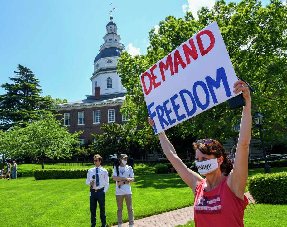 Kim Stuart of Westminster, Md., demonstrates in Annapolis on May 15, 2020, against restrictions Maryland Gov. Larry Hogan, a Republican, imposed to slow the spread of the novel coronavirus. Photo: Washington Post Photo By Jonathan Newton / The Washington Post