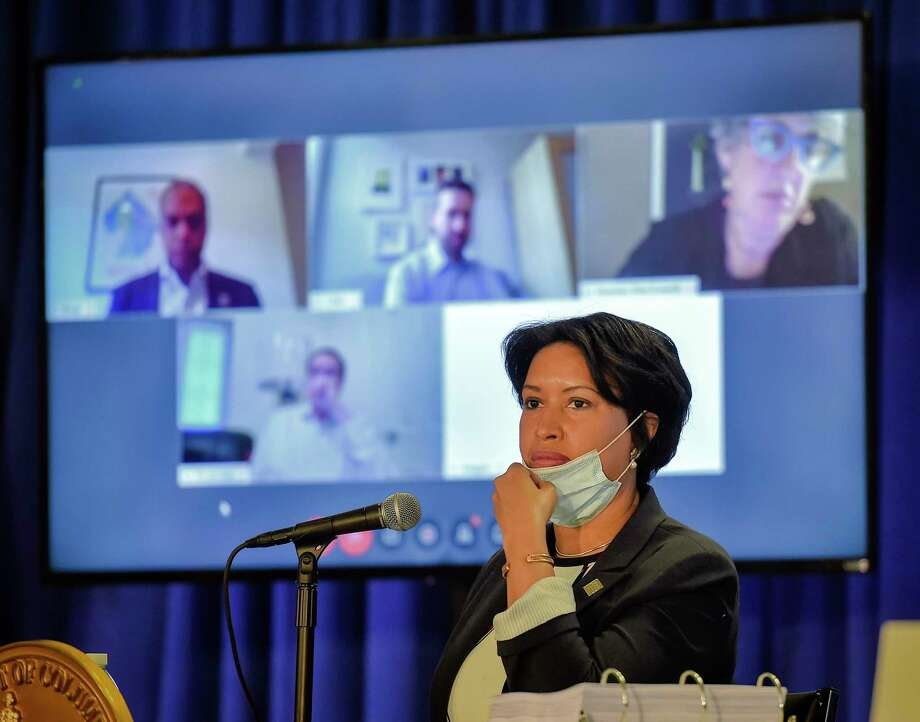 District of Columbia Mayor Muriel Bowser, a Democrat, adjusts her face mask as she presides over a meeting with council members on Monday, May 18, 2020. Photo: Washington Post Photo By Bill O'Leary / The Washington Post