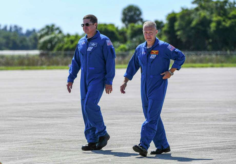 NASA astronauts Doug Hurley (right) and Bob Behnken arrive at Kennedy Space Center. They're scheduled to blast off May 27 atop a SpaceX Falcon 9 rocket, bound for the International Space Station. Photo: Washington Post Photo By Jonathan Newton / The Washington Post
