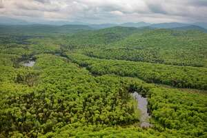 The view from above of the vast Adirondack Park, N.Y. on May 31, 2019. Roughly six million acres comprise the Adirondack state park and some 2.6 million acres of forest preserve contain broad stretches that are open to public recreation. (Tony Cenicola/The New York Times)