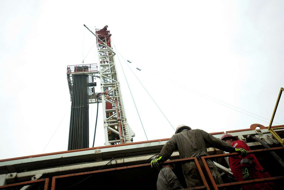 A rig drills for natural gas at a hydraulic fracturing site atop the Marcellus Shale rock formation in Washington Township, Penn.