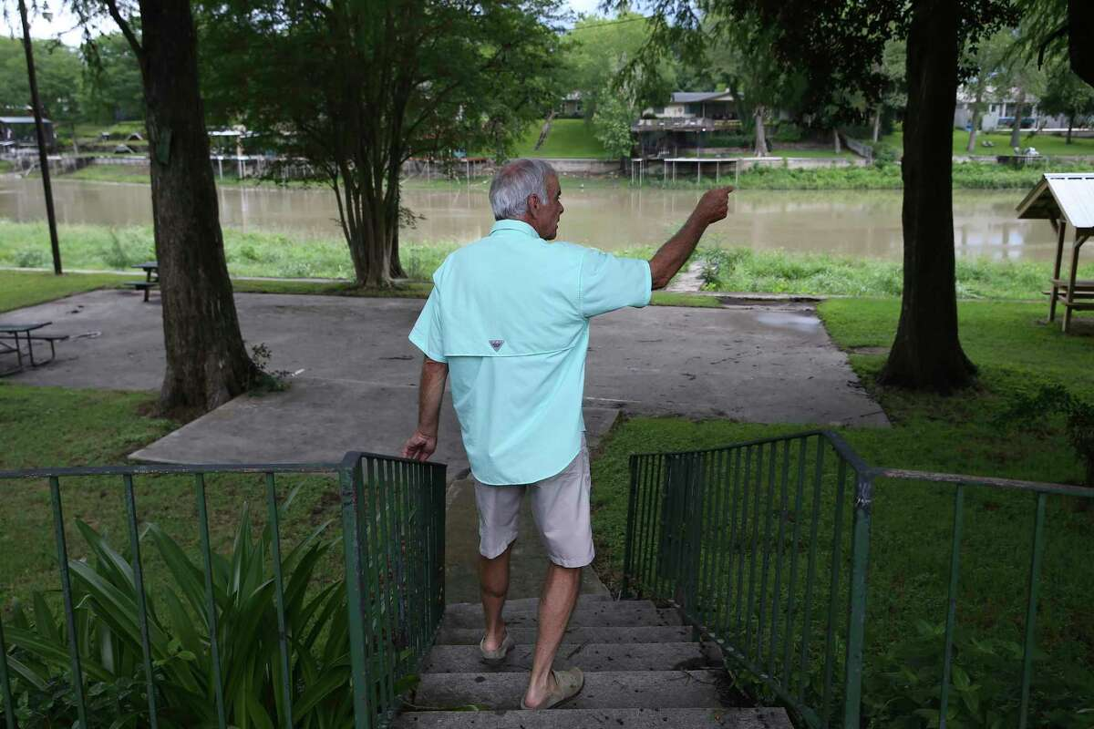 Greg Brazeal, 71, talks about life on Lake Dunlap, Monday, May 25, 2020. The dam that created the lake was built in 1931 to provide hydroelectric power. It failed on May 14, 2019 and the lake drained leaving only the natural path of the Guadalupe River. Brazeal lives in the River Bend community of the lake.