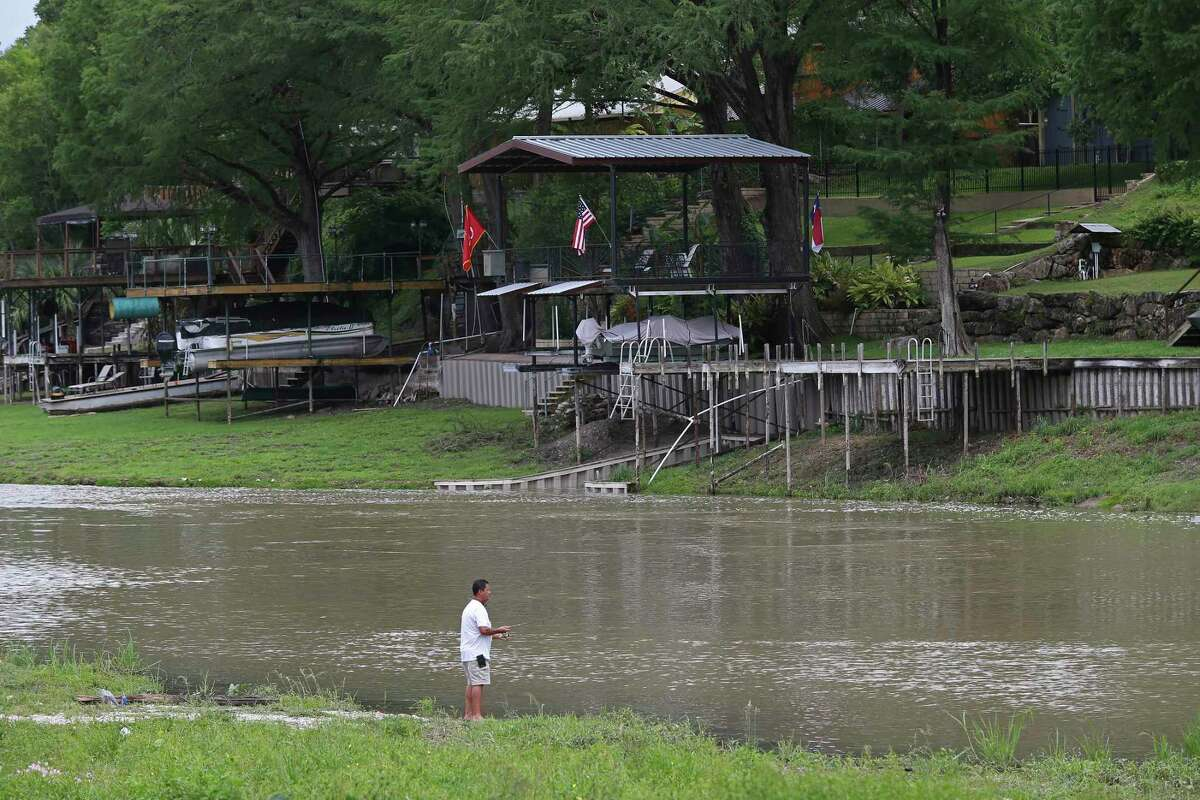 Rene Nava, 58, of Lubbock, Texas, fishes the Guadalupe River at Lake Dunlap, Monday, May 25, 2020. Nava has a house in the River Bend community of the lake. The dam that created the lake was built in 1931 to provide hydroelectric power. It failed on May 14, 2019 and the lake drained leaving only the natural path of the Guadalupe River.