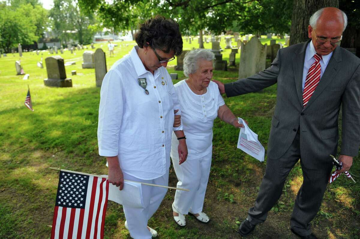 U. S. Rep. Paul Tonko, right, helps Gold Star Mothers Carrie Farley, mother of Staff Sgt. Derek Farley, left, and Marie Ladouceur, mother of 1st Lt. Lanny Ladouceur, center, walk from Beverwyck Cemetery following ceremonies there, before the start of the Rensselaer Memorial Day Parade on Sunday May 29, 2011 in Rensselaer, NY. Farley was killed in Afghanistan last year, while Ladouceur was killed in Vietnam in 1970. ( Philip Kamrass / Times Union)