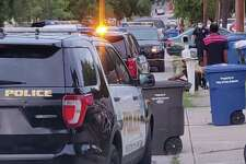 Police vehicles line the street Monday, May 25, 2020 at the scene in the 1400 block of Avant Avenue where police say a 4-year-old boy was shot and killed during a Memorial Day barbecue at a home.