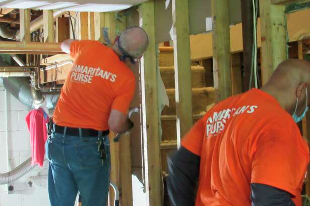 Volunteers with Samaritan's Purse work at a house on Monday, May 25 in Midland. (Victoria Ritter/vritter@mdn.net)