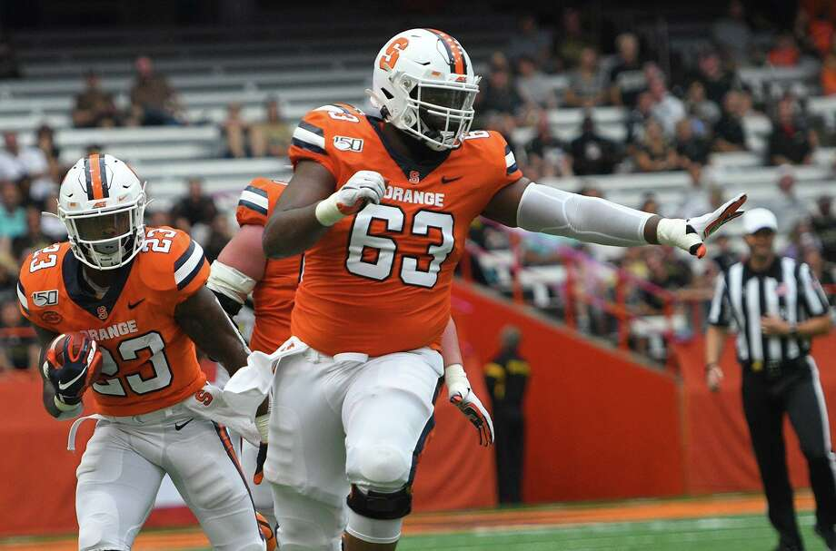 Norwalk's Evan Adams (63) in action for the Syracuse football team. Photo: Syracuse University Athletics / Syracuse University Athletics