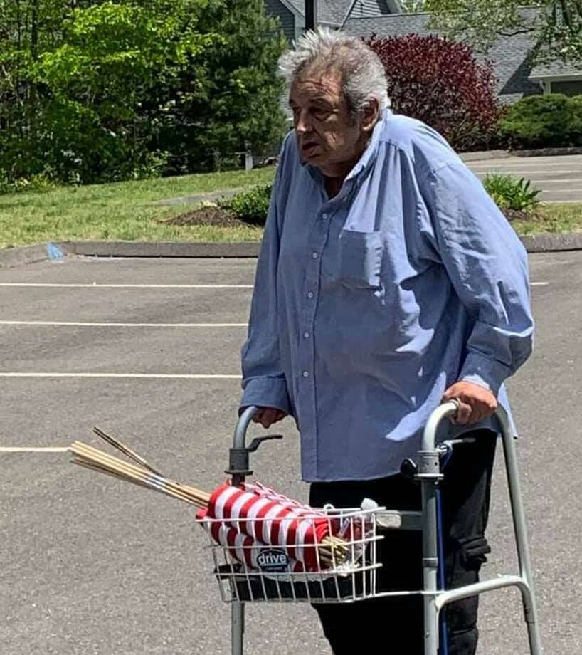 Joseph Bennetta spent the days prior to Memorial Day walking around the Meadow Lake Condominium complex in which he lives, placing American flags at each home. Photo: Contributed Photo / / Connecticut Post