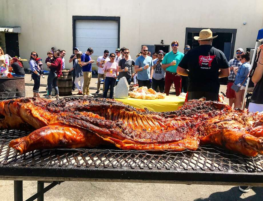 """Hoodoo Brown's on Route 7 is roasting a whole pig today and giving """"whole hog sandwiches"""" to those in need, to celebrate the restaurant's fifth anniversary. Photo: Contributed Photo / Hearst Connecticut Media"""