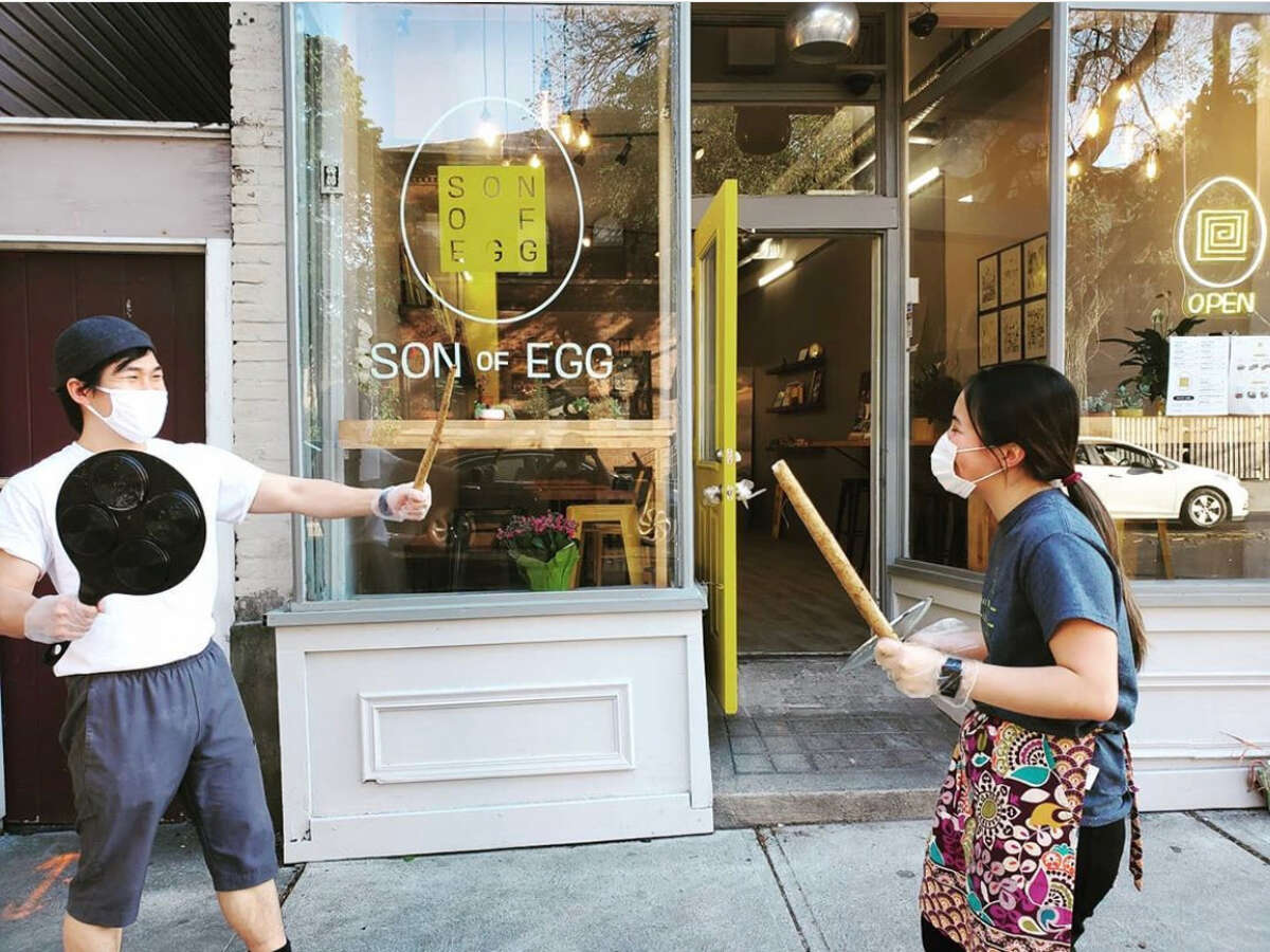 Son of Egg owner Min Cho Ko, right, and her son Justin joke around in front of the family's new Albany restaurant.