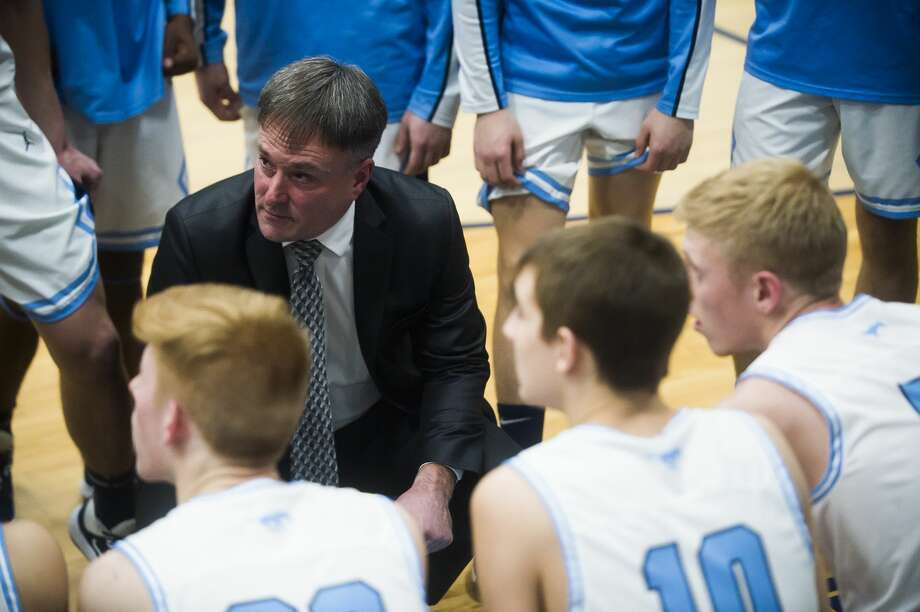 Meridian boys' basketball coach and athletics director Mitch Bohn — seen here during a timeout in a Feb. 5, 2020 game against Beaverton — is part of a work crew which has been helping with Sanford flood clean-up efforts the past several days. Photo: Daily News File Photo