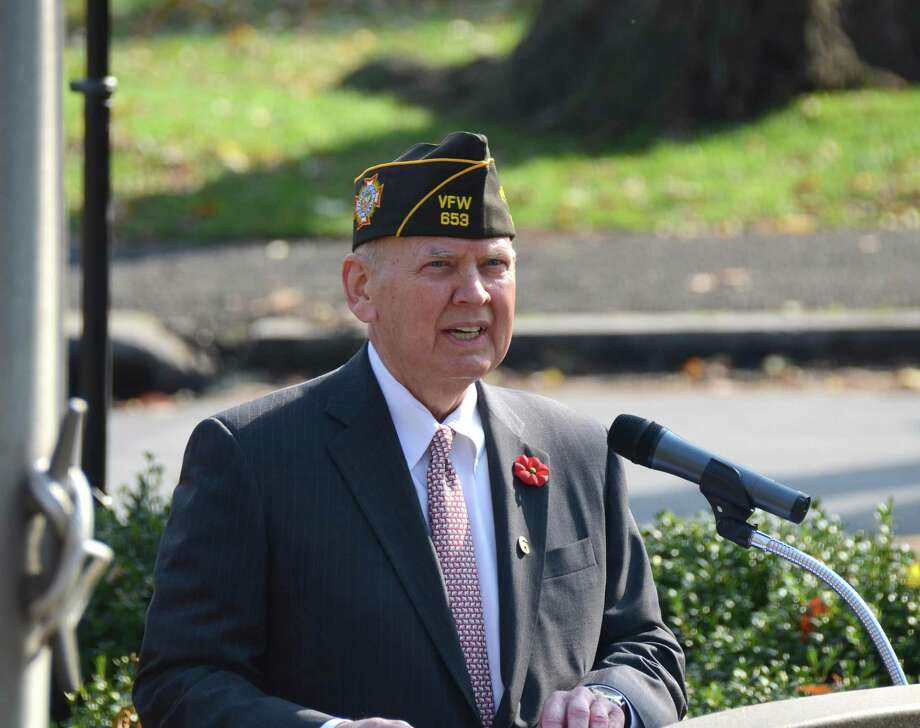 Commander Peter Langenus welcomes veterans and all the community to New Canaan's Veterans Day ceremony at God's Acre on a previous Sunday. Photo: Jeanna Petersen Shepard / Jeanna Petersen Shepard / New Canaan News