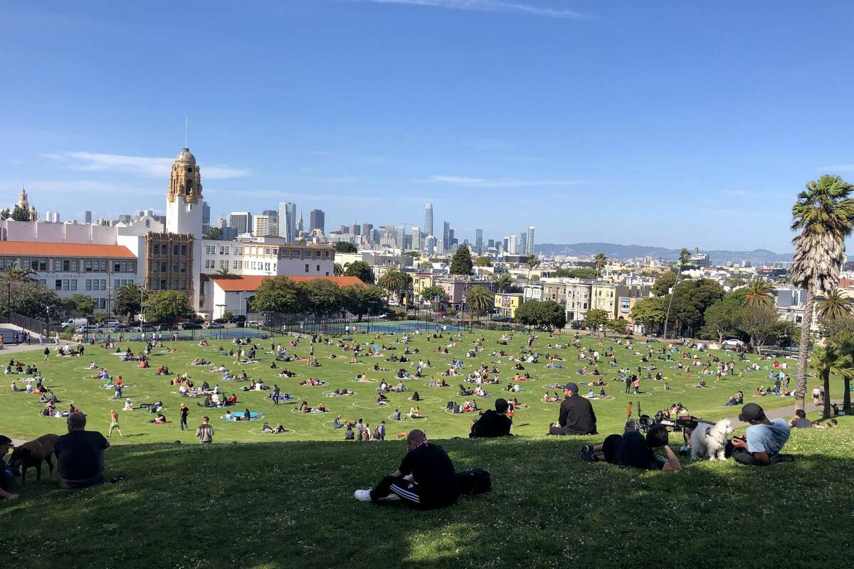 People are seen at the Dolores Park during Covid-19 pandemic in San Francisco, California United States on May 22, 2020.