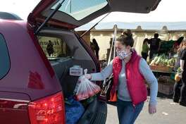 A food pantry loads a vehicle in East Hartford, Conn. On Tuesday, the Connecticut Department of Labor began accepting applications under the Pandemic Emergency Unemployment Compensation program that provides an extra 13 weeks of benefits for those whose existing 26-week benefit window has expired.
